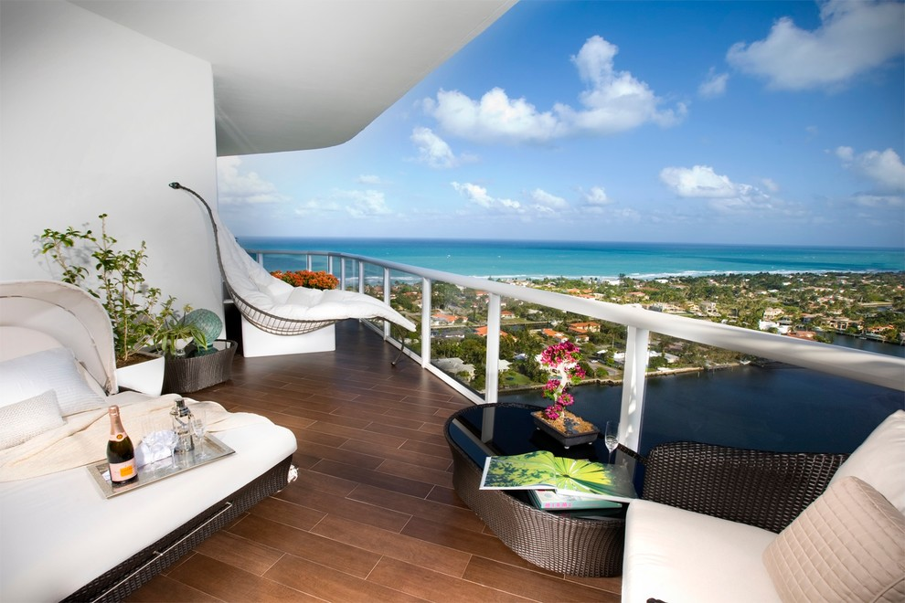Wood Look Porcelain Tile Patio Modern with Balcony Beach Front Beach View Black Glass Overlay Blue Sky Clouds Hammock
