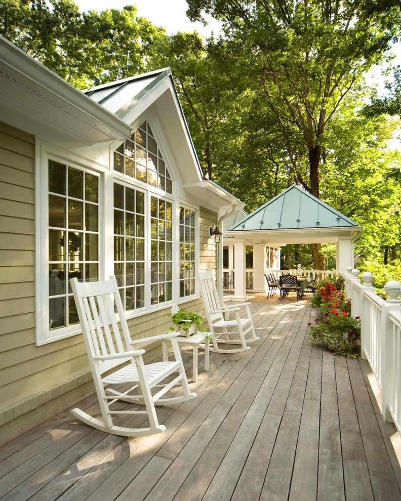 Wood Rocking Chair Deck Traditional with Metal Roof Patio Furniture Potted Plants Standing Seam Roof White Trim Wood