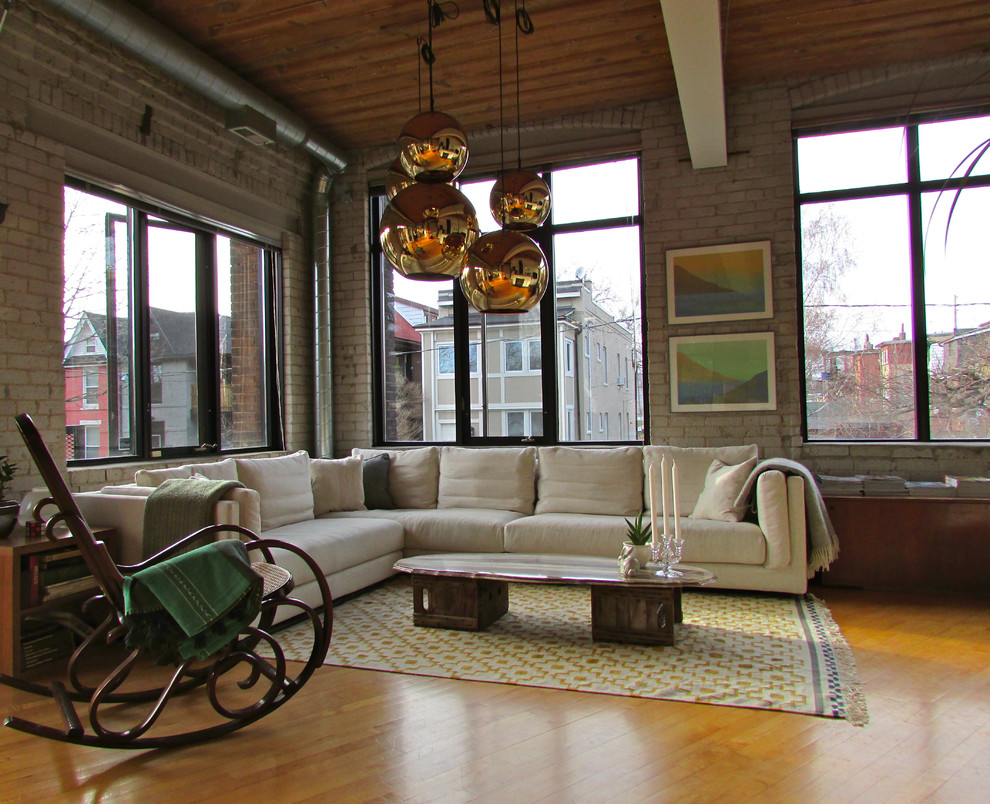 Wood Rocking Chair Living Room Industrial with Arched Windows Black Window Trim Bronze Pendant Exposed Beams Exposed Ventilation Duct