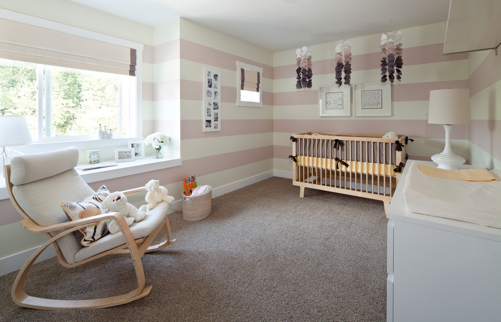 Wood Rocking Chair Nursery Transitional with Baby Room Beige Roman Shade Beige Striped Wall Carpet Crib Mobile Girls