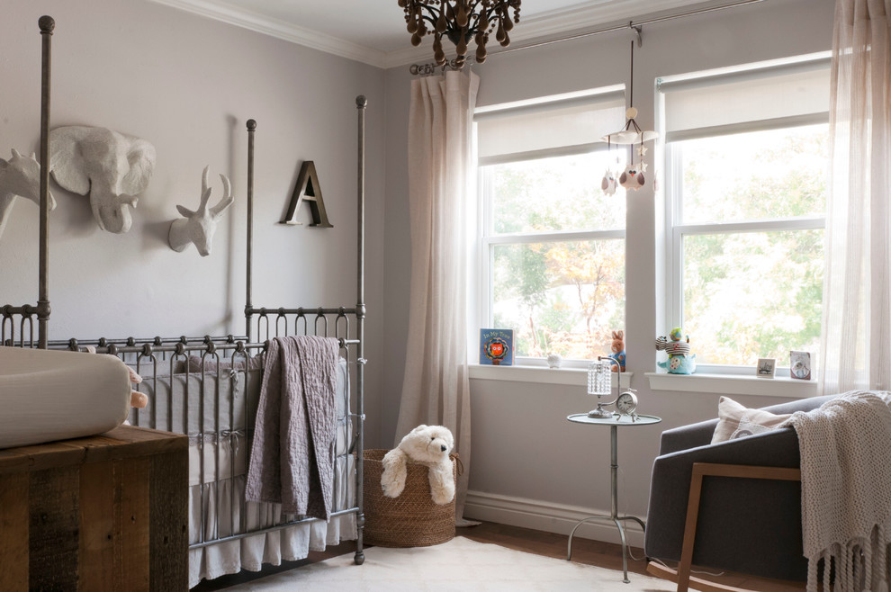 wooden chandeliers Nursery Transitional with area rug Baby Room baseboard basket changing table crib crib bedding crown