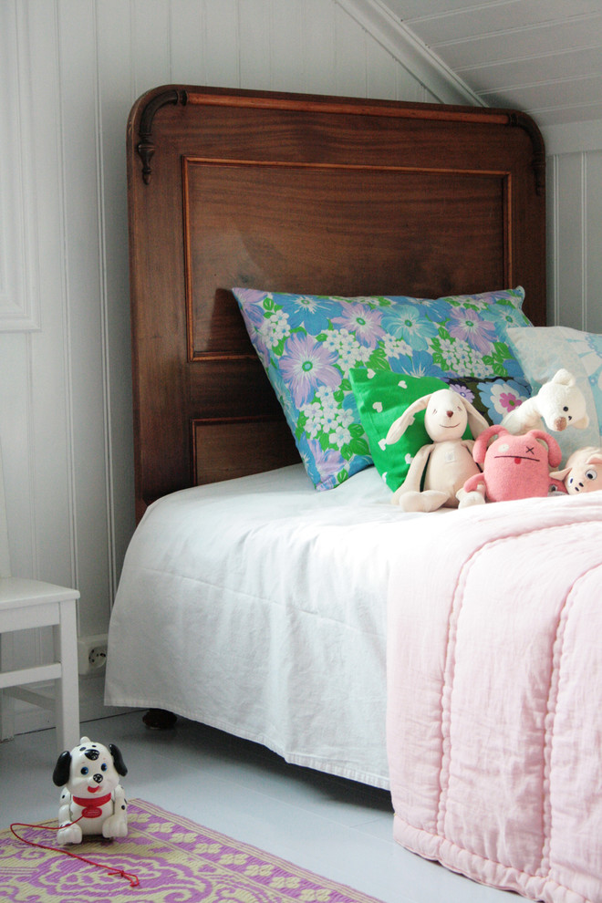 wooden headboard Kids Scandinavian with area rug attic beadboard bed pillows Bedroom floral pillows painted wood sloped