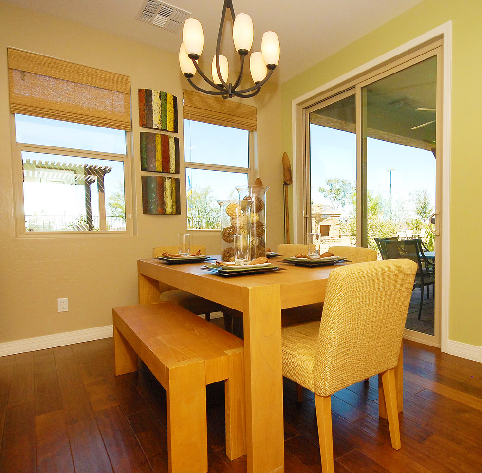 wooden picnic tables Dining Room Contemporary with basket weave chairs green accent wall green wall Shea Homes Shea homes