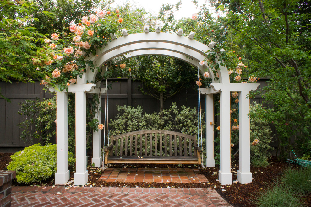 wooden swings Landscape Traditional with brick patio bricks bushes peach flowers porch swing post shrubs swing white