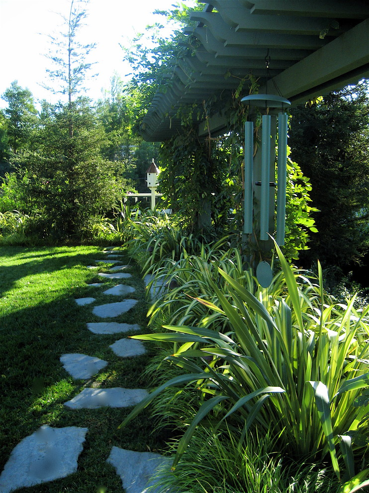 wooden wind chimes Landscape Traditional with arbor flagstone foliage grass lawn new zealand flax path pavers trellis turf
