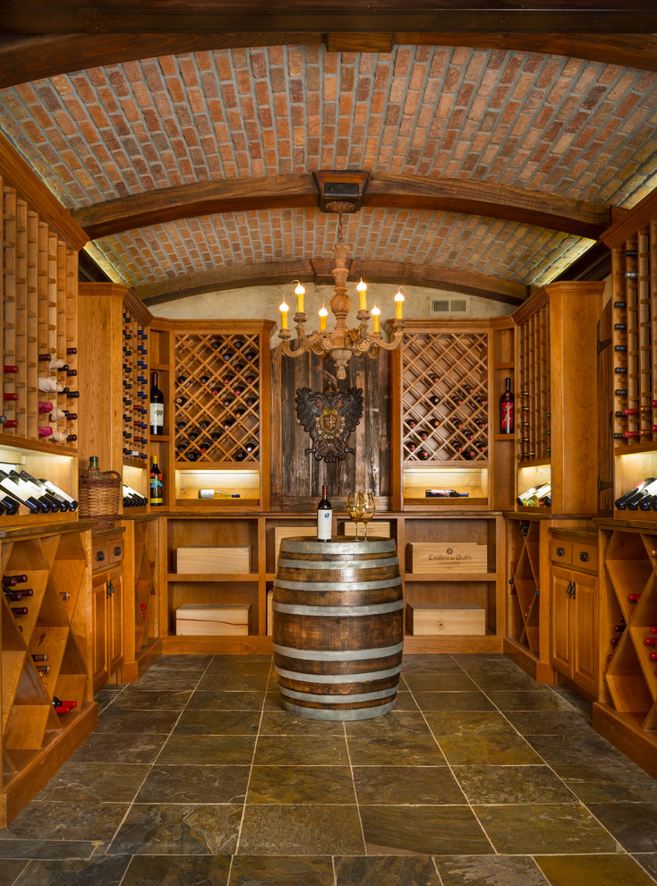 Wooden Wine Racks Wine Cellar Rustic with Arched Beams Arched Ceiling Branching Chandelier Brick Ceiling Brown Tile Floor Candle