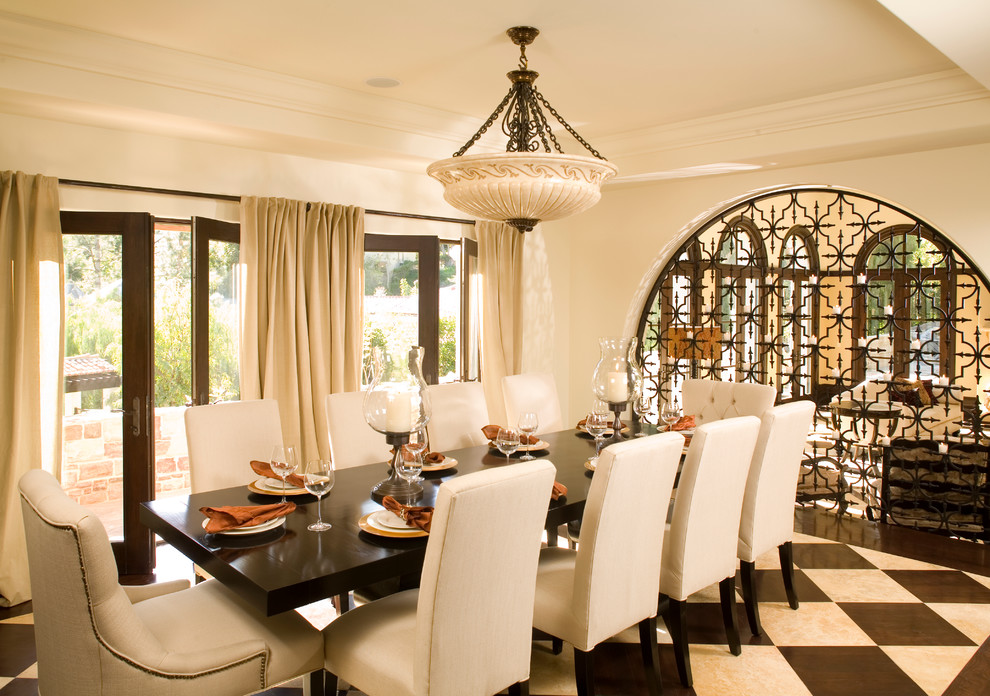 Wrought Iron Bistro Set Dining Room Mediterranean with Archway Bowl Chandelier Crown Molding Curtains Drapes French Doors Harlequin Floor Pattern