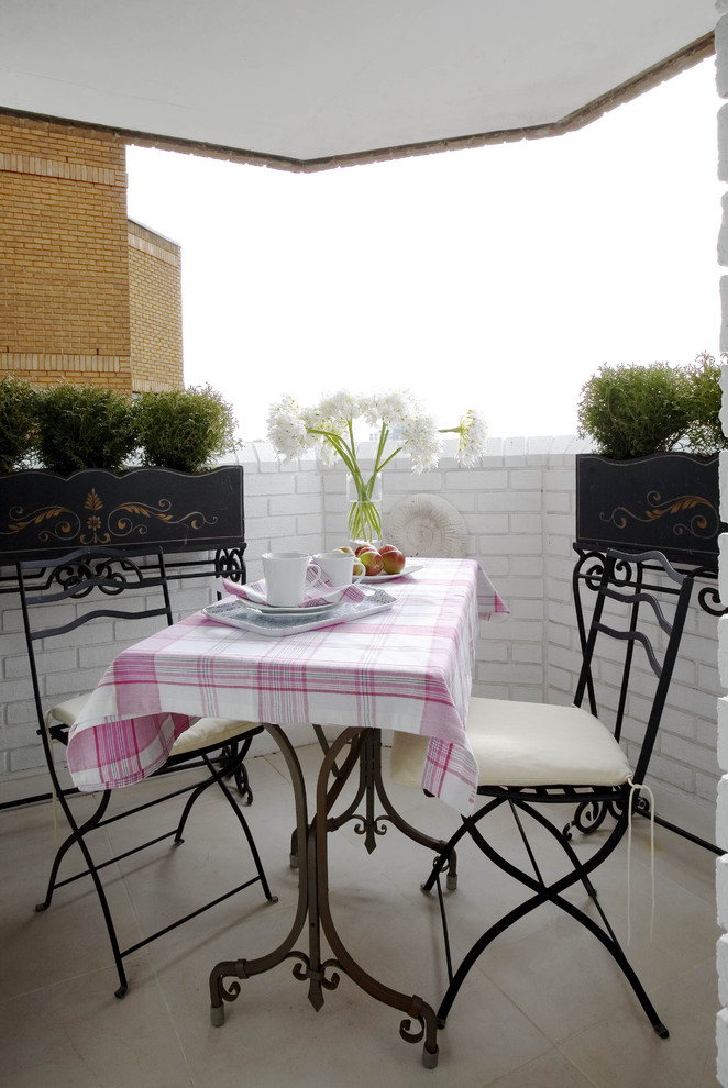 Wrought Iron Bistro Set Patio Eclectic with Balcony Brick Centerpiece Covered Patio London Outdoor Dining Pink Planter Tablecloth Tile
