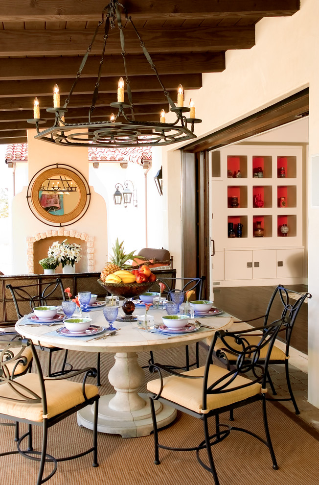 wrought iron patio furniture Patio Mediterranean with cast stone covered outdoor spaces covered patio exposed beams exposed joists fruit