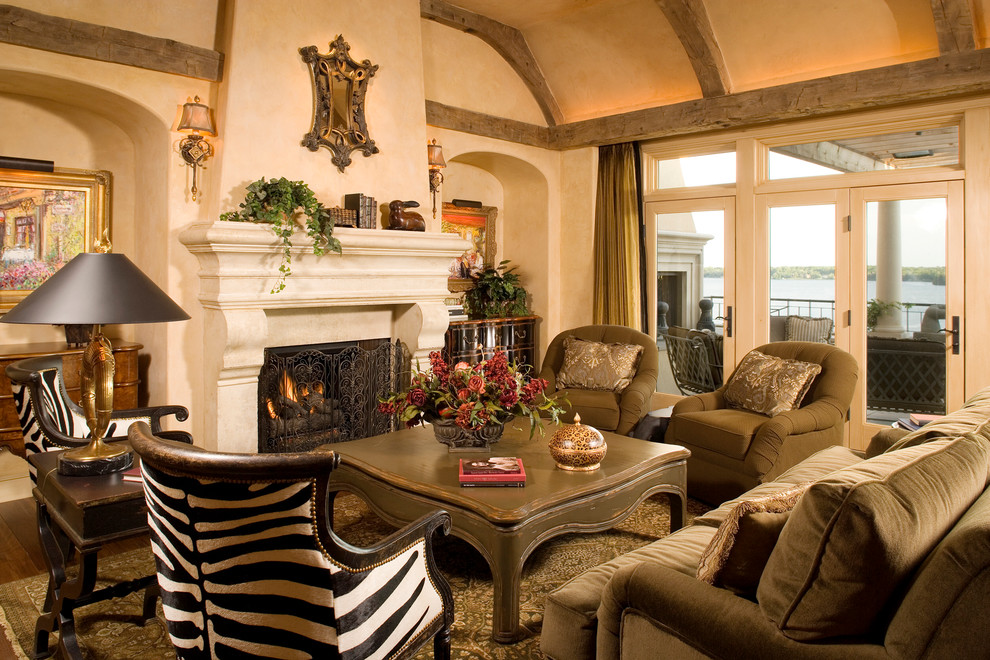 zebra print chair Family Room Mediterranean with area rug armchairs carved stone cove lighting formal french doors iron fire