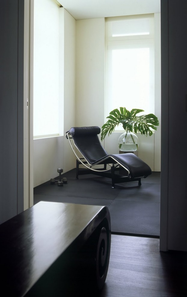 Zero Gravity Massage Chair Living Room Modern with Black Rug Black Wood Floor Exercise Room Glass Vase Palm Fronds Weights