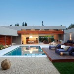 Board and Batten Siding  Contemporary Pool with Wood Paneling
