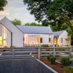 Board and Batten Siding  Farmhouse Exterior with Green Planters
