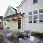 Board and Batten Siding  Farmhouse Exterior with Molded Plastic Outdoor Furniture