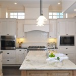 Colonial Cream Granite  Traditional Kitchen with Tile Backsplash