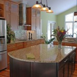 Giallo Ornamental  Contemporary Kitchen with Glass Tile