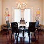 Orb Chandelier  Contemporary Dining Room with Dark Stained Wood Floor