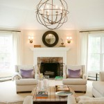 Orb Chandelier  Transitional Living Room with Red Brick Fireplace Surround