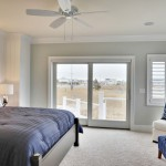 Sherwin Williams Sea Salt  Beach Style Bedroom with Wall Art
