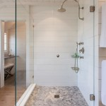 Shiplap Siding  Beach Style Bathroom with Corner Shower
